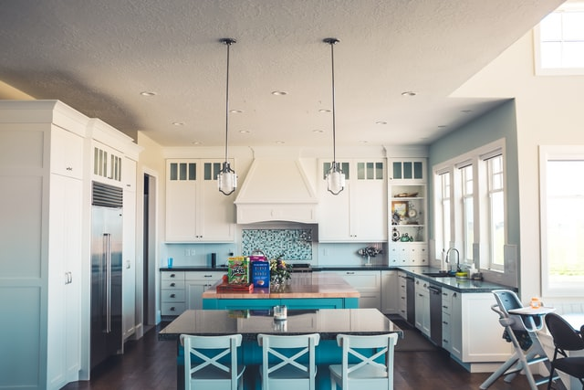 A-blue-and-white-open-concept-kitchen-with-pendant-lights.